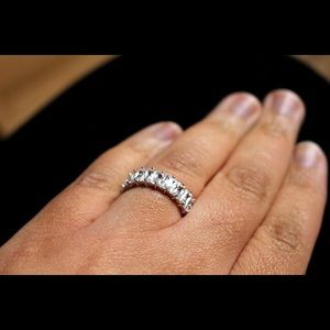 Emerald cut eternity band ring